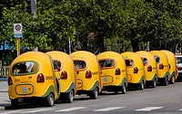 Yellow cocotaxis in Havana, Coco taxis is a typical cheap taxi in Cuba