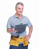 Portrait of a mature handyman with a notepad isolated against white background
