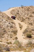 Jeep going up steep hill, Redrock Canyon, California, USA