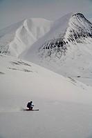 Telemark skier going downhill, Lapland, Sweden.