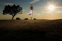 A woman doing yoga, Gotland, Sweden.
