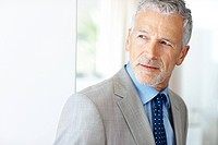 Closeup portrait of a handsome mature business man looking away _ Copyspace