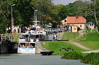 A passenger steamer passing through a narrow lock, Sweden.