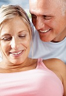 Closeup portrait of mature couple smiling together