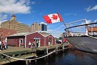 boat with flying Canadian Flag mooring at the Harbour Walk of Halifax, Nova Scotia, Canada, North America