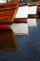 Boats reflected in the lake Bowness on Windermere Cumbria England