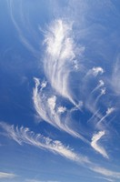 strange white cloud formation with blue sky