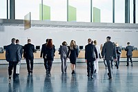 Delegates walking towards the check_in desks a conference centre