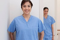 Smiling nurses in scrubs