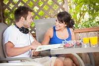 Couple eating breakfast on patio