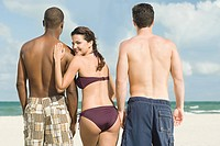 Woman and two men at the beach