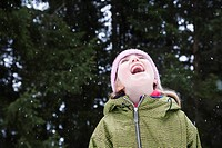 Girl catching snow flakes in her mouth