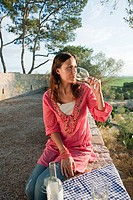 Young woman drinking wine on holiday