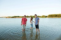 Three friends having fun in lake