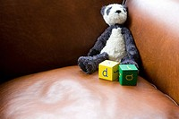 Panda toy and building blocks on sofa