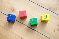 Baby spelled out in building blocks