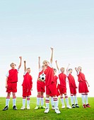 Littler soccer players cheering on field