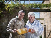 Beekeepers with honey comb and honey