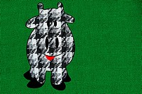 Dogtooth check cow on green background