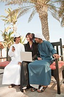 Middle Eastern people with laptop and mobile phone