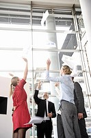 Business team throwing papers in the air