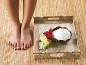 A pair of female feet next to beauty care products