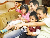 Family cheering in television room