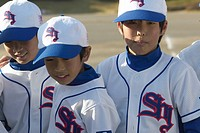 Boys in baseball uniform standing