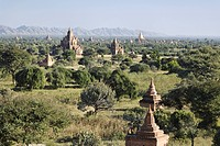 Historic Brick Ruins and Trees With a Mountain Range in the Distance. Bagan, Myanmar
