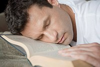 Man sleeping on an open book