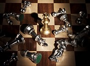 Fallen chess pieces surrounding the rook