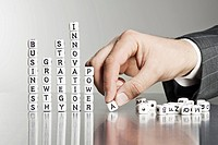 Businessman forming words from alphabet blocks