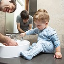 Man with toddler son in the bathroom
