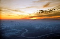 Sunset over hazy river