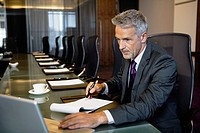 Businessman working at conference table