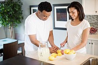 Couple cutting lemons
