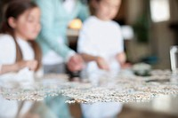 Family doing puzzle (thumbnail)