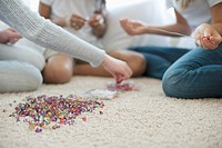 Girls making bead necklaces