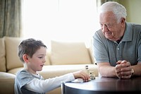 Grandfather playing dominos with grandson