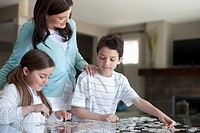 Family working on a jigsaw puzzle (thumbnail)