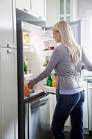 Woman looking in refrigerator (thumbnail)