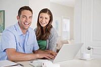 Couple using computer (thumbnail)