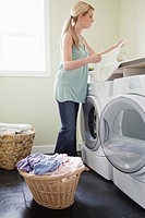 Woman doing laundry (thumbnail)