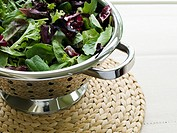 Colander filled with fresh lettuce