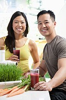 Young couple having healthy smoothies