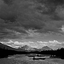 River passing through a forest with mountains in the background, Athabasca River, Mt Kerkeslin, Jasper National Park, Alberta, Canada