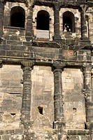 TWO PEOPLE WAVING HANDS IN PORTA NIGRA, THE ROMAN CITY GATE OF TRIER. GERMANY