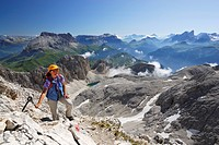 Woman ascending to mount Kesselkogel, Rosengarten group, Dolomites, Trentino_Alto Adige/South Tyrol, Italy