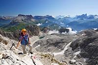 Woman ascending to mount Kesselkogel, Rosengarten group, Dolomites, Trentino_Alto Adige/South Tyrol, Italy