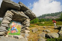 Wayside shrine, hiker in background, Alpe Corte Nuovo, Valle Bavona, Ticino range, Ticino, Switzerland